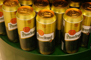 POZNAN, POLAND - JANUARY 18, 2014: Pilsner Urquell beer in cans for sale at a supermarket